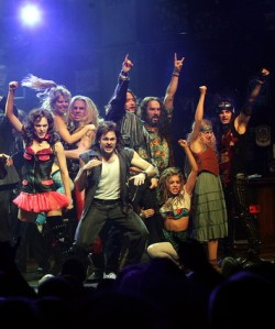 The cast of Rock of Ages, bringing the rock, and rocking it hard.